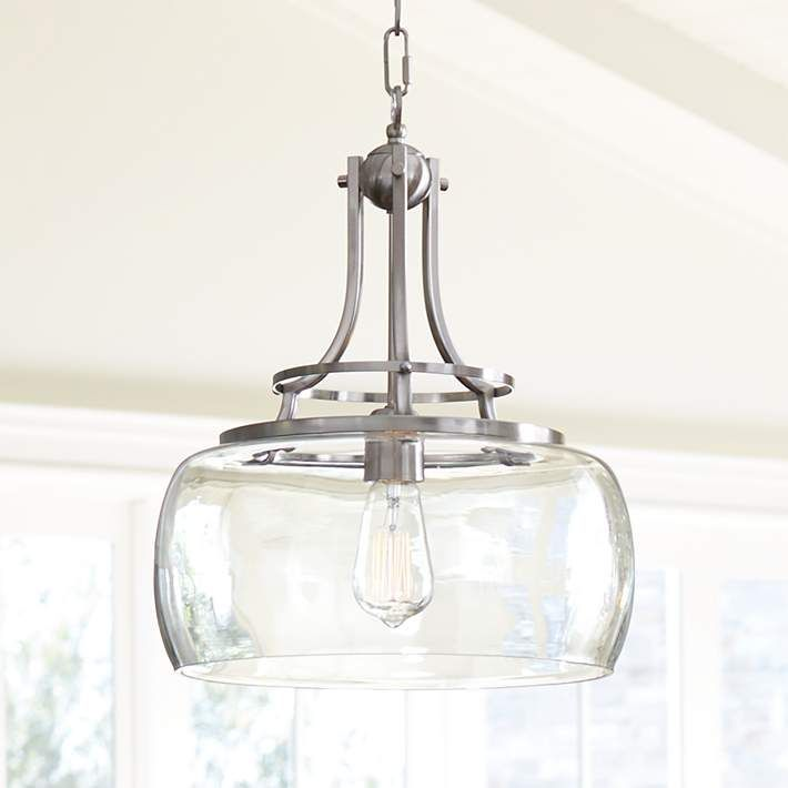 "I suggest this instead for the island. The flowing shape is elegant yet the farm/ranch scheme is evident. Then choose the Dining and Entry pendants more formal if you wish. Charleston 13 1/2"" Wide Brushed Nickel Pendant Light - #7P203 