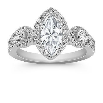 This vintage white gold halo ring is absolutely perfect for a marquise cut diamond. Available with your choice of diamond, ruby, or sapphire.
