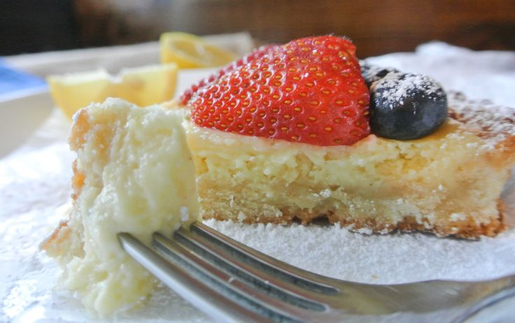 buttery almond shortbread crust filled with a lemon curd and cream ...