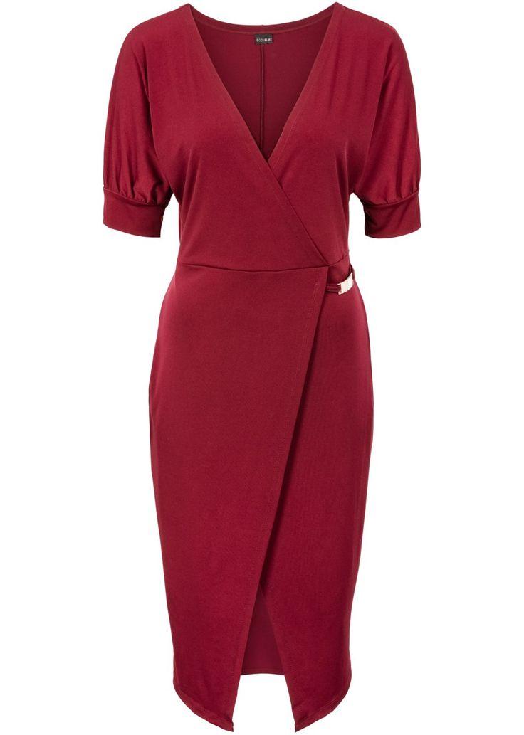 Se nu:Vacker klänning från BODYFLIRT. Med en moderiktig, djup V-ringning och halvlånga ärmar. Med ett chict, dekorativt smycke i midjehöjd. Kjolen har en vacker omlottlook. Längd ca 104 cm i strl. 36/38.