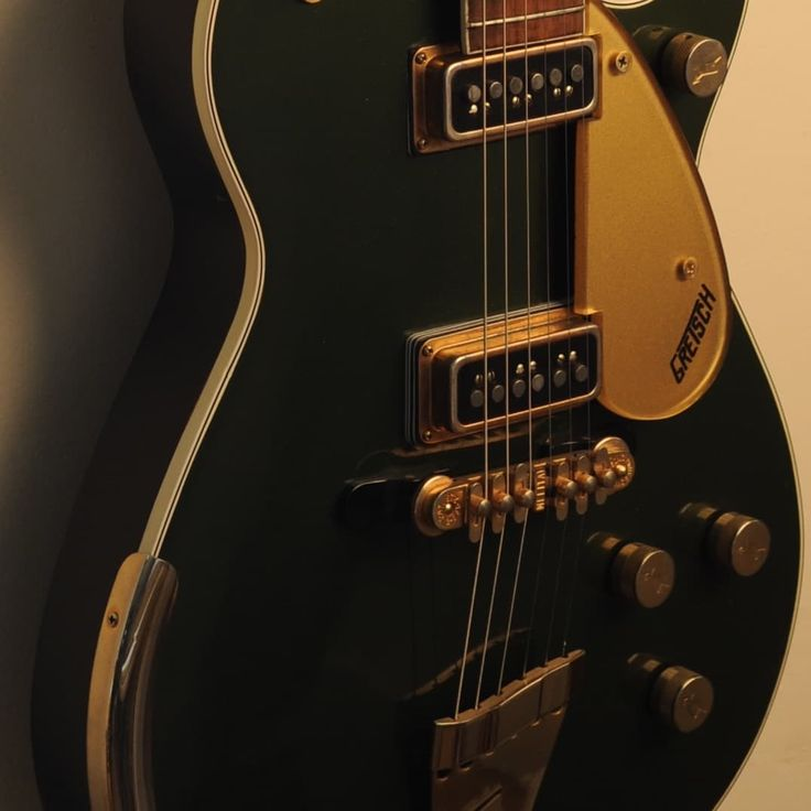 This incredible guitar is a near mint 1957 Gretsch 6128 Duo Jet in the original Cadillac Green factory finish. This guitar is 100% factory original as it left the Gretsch factory in 1957. Condition is near mint, and includes the original checkered Gretsch, purple lined, 5 latch case, also in ver...
