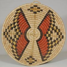 The design of this plaque is very subtlety divided into four quadrants by a very faint green pigment applied over the yucca, a technique I have not seen before on Hopi basketry. The two large designs with red appear to possibly represent an unmarried Hopi girl's hair whorl, but this is speculation on our part. It is conceivable that this was used in a ceremonial function relating to a young Hopi female.