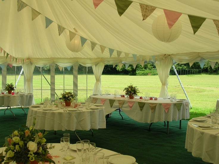 Pretty country themed wedding marquee with oval table...