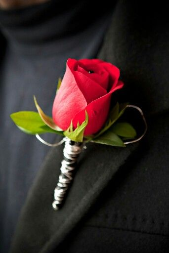 A red rose with silver aluminum wire boutonniere for prom