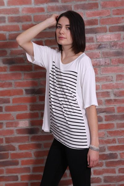 Black and white stripe, tunic t-shirt with small side slits. Dropped hem, slightly ruched sleeve detail. Wear this anywhere, anytime - it really is the perfect top