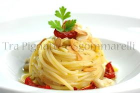 Spaghettoni 'Agrumati' con Coda di Rospo, Pomodorini Confit e Mandorle Tostate al Sale - Tra Pignatte e Sgommarelli