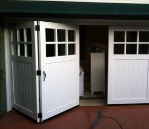 Carriage Doors. Bifold-True-carraige-garage-doors-with-accordian-hardware-Tungsten-Royce