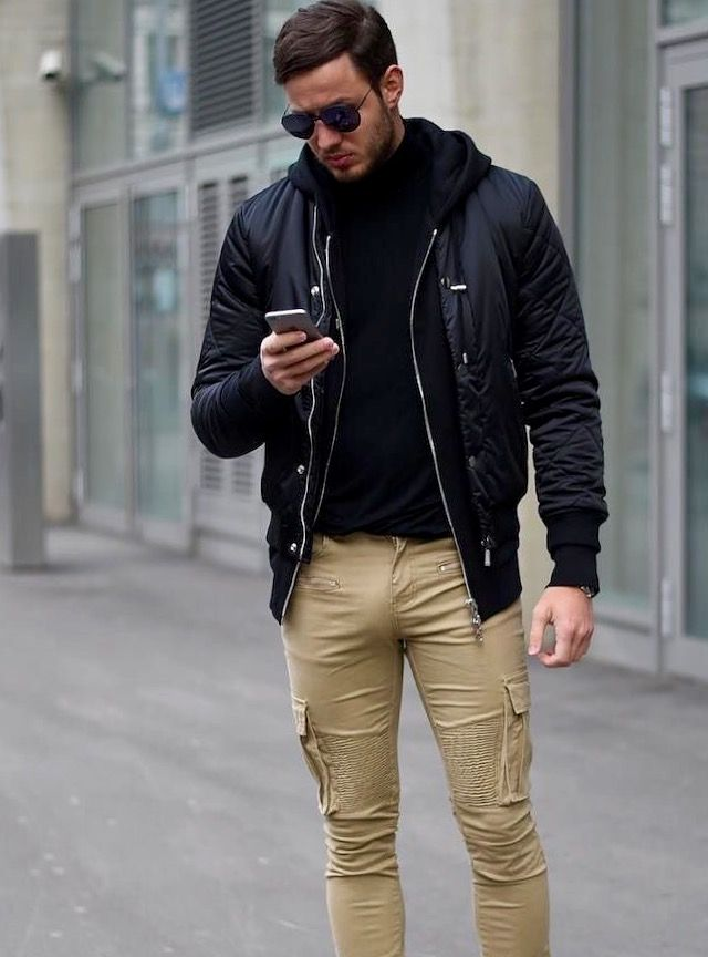 Dark jacket and sweater paired with a kaki pair of cargo pants!