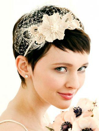 I love this headband...but I might add a birdcage veil to it