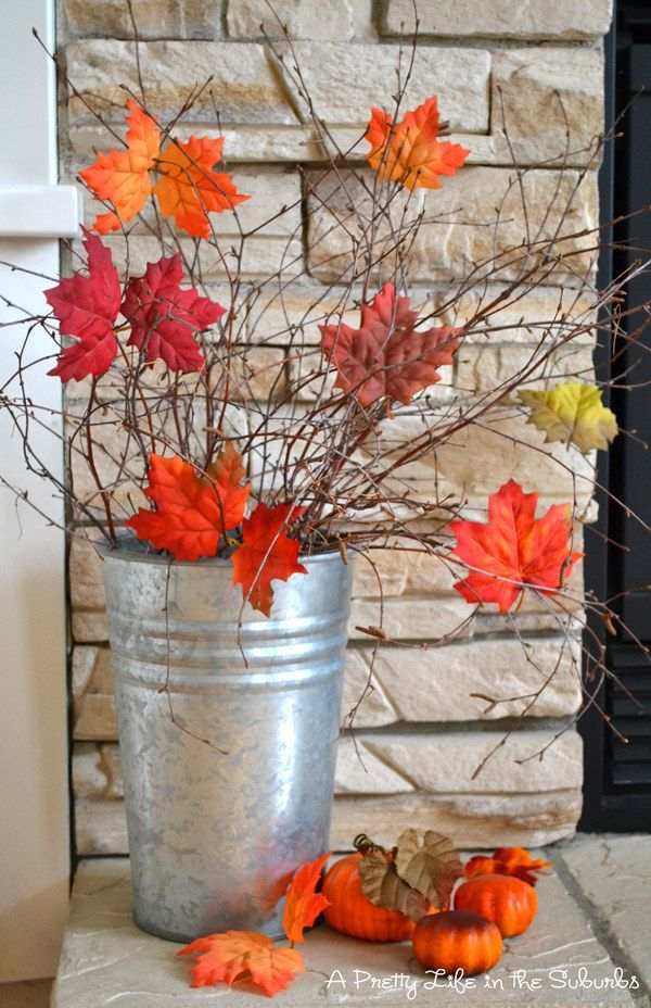 Create a simple but festive arrangement with faux leaves and branches. | 21 Fall Porch Ideas That Will Make Your Neighbors Insanely Jealous