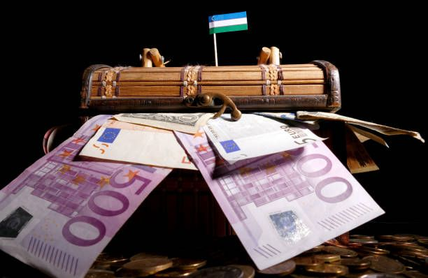 uzbekistan flag on top of crate full of money