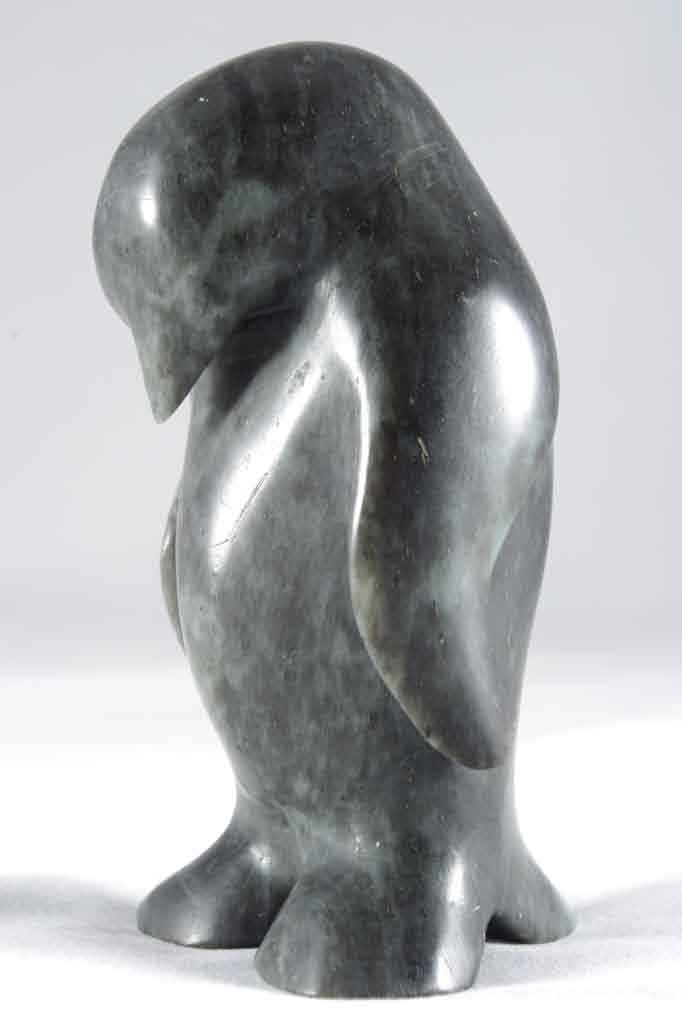 Side-view of shy penguin stone sculpture by Canadian Sculptor Kim S.. Warne
