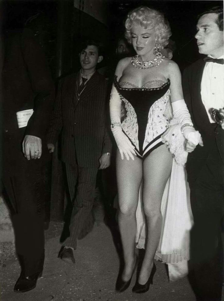 Marilyn Monroe and Milton Greene at a Madison Square Garden Charity Circus Gala, NYC, March 30, 1955.