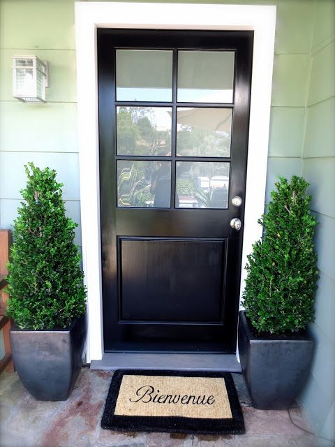 black front door glossy boxwood topiaries plants potted charcoal gray ceramic planters Bienvenue doormat