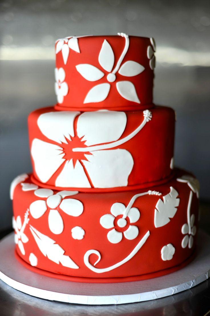 Red Hawaiian themed destination beach wedding cake