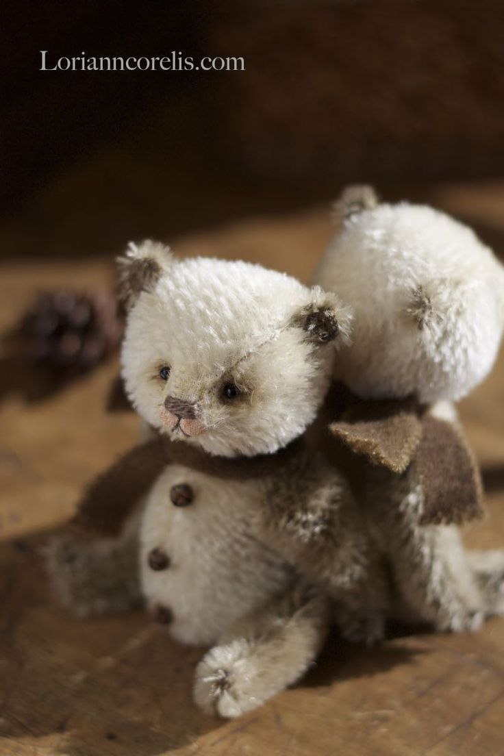 "Snowy Pandas ~ Created from soft and gentle winter colors of creme and taupe and mohair. These sweet fellas are a smidgen over 5"" tall, fully jointed they are stuffed heavy with steel shot to nestle into your hand! Each wears a woolen scarf and has 3 teeny bells down his tummy. They come nestled into a sweet box tied up with twine. Each are $170.00 SOLD"