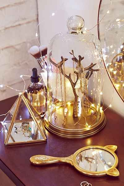 For my vanity. So Beauty and the Beast :)  Magical Thinking Glass Cloche Jewelry Stand - Urban Outfitters