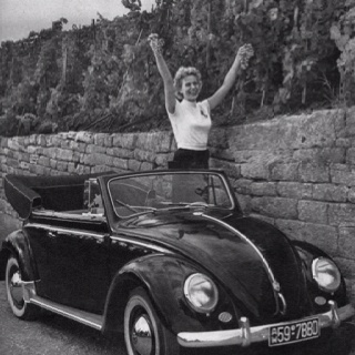 Happy VW Beetle cabrio lady...of course she's happy! She's driving a bug!