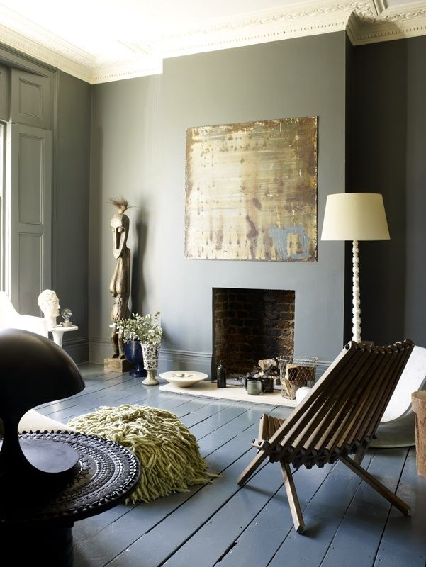 Grey lounge with painted floors and shutters with gold accents. Takes my breath away. Magical. Love the fireplace