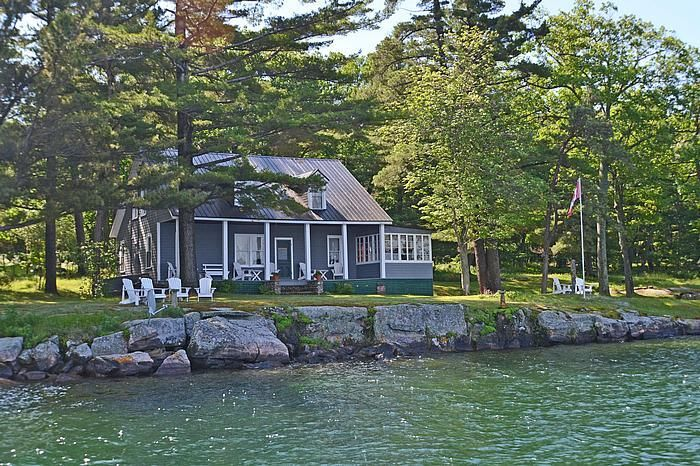 UNIQUE & CHARMING WITH LOTS OF ROOM TO GROW! Invest in your future! This olde river property has 5+ bedrooms, 2 baths, a bunkie and a totally separate 2-storey boathouse with 5 more bedrooms, a bathroom and, a separate kitchen/dining house with stone fireplace. The river views are classic and stunning. The water is deep and clean, the golf and tennis club is 2 minutes away and the marina 10 minutes. Everything about it has been meticulously maintained! $875,000.