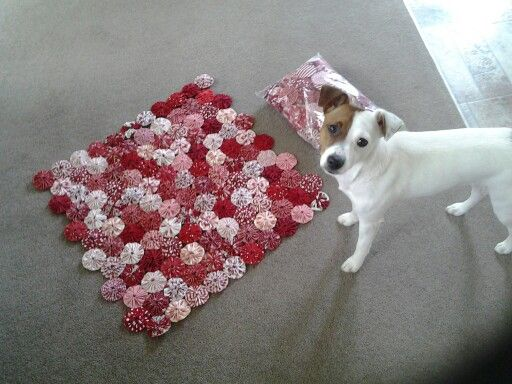 Red and white yoyo quilt