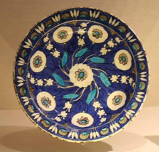 Blue-ground dish with floral Design | Iznik, Turkey, ca. 1550-1560 | Stonepaste; polychrome painted under a transparent glaze | The Metropolitan Museum of Art, New York