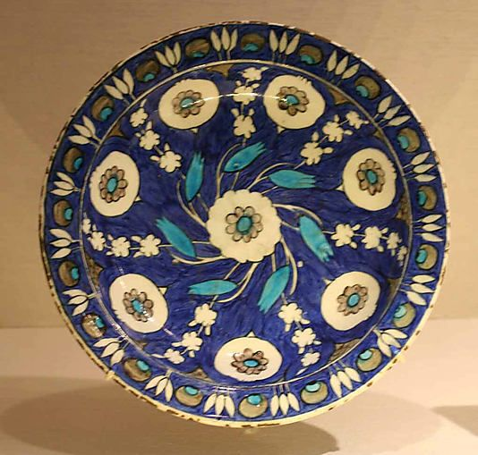 Blue-ground dish with floral Design | Iznik, Turkey, ca. 1550-1560 | Stonepaste; polychrome painted under a transparent glaze | The Metropolitan Museum of Art, New York
