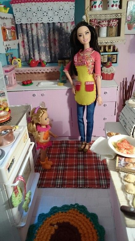 In the kitchen with barbie and Chelsea