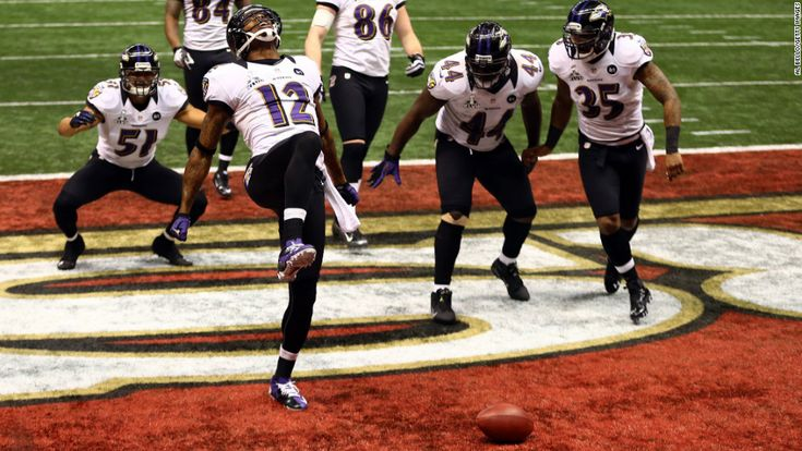 """Jacoby Jones of the Baltimore Ravens, No. 12, does """"the Ray Lewis dance"""" to celebrate his 108-yard kickoff return for a touchdown at the start of the third quarter."""