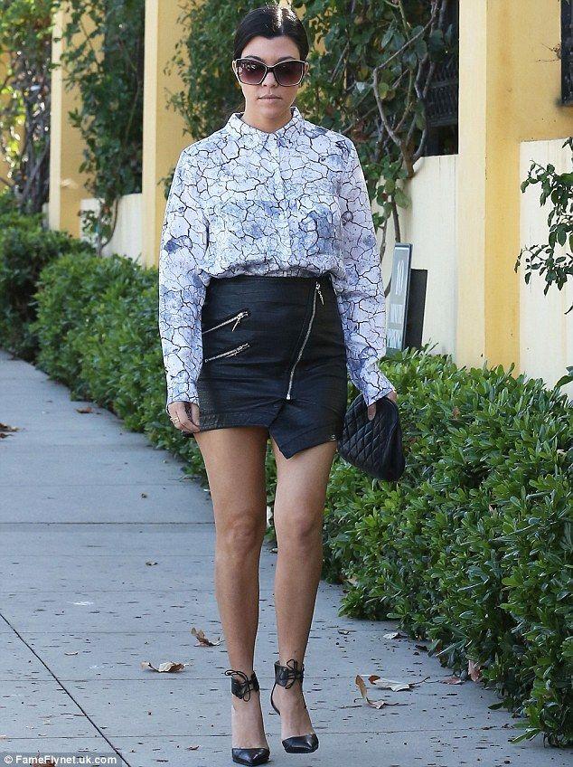 Sexy Star Kourtney Kardashian Showed Off Her Toned Legs In A Leather Mini Skirt As She Gr