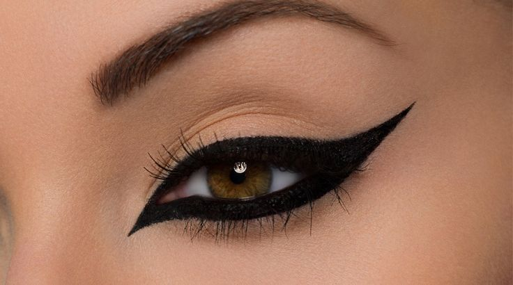 Learn the sexy and dramatic eyeliner technique.  Trace a Cat Liner line along the base of the upper lashes.   Apply the Eyeliner from the outer corner to the center of the base of the lower lashes.  Take up the line from the inner corner to the center of the eye, joining the two lines t