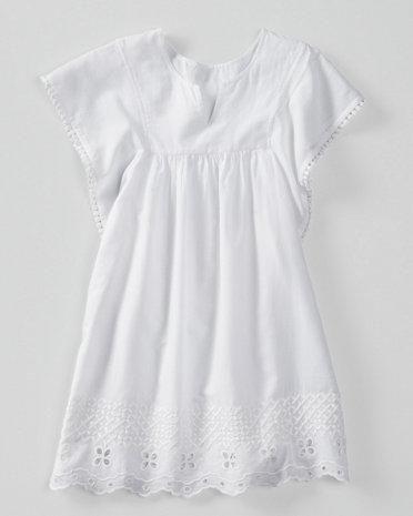 With an easy A-line shape and dramatic batwing sleeves, this cover-up looks cool over a bathing suit or cami and shorts.