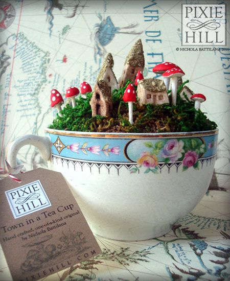 Miniature Mossy Fairy Town in a Teacup Filled with Moss, Faerie Whimsy and Dreamy Delight.  Etsy by PixieHillStudio
