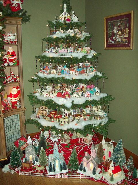 Original pinner said - This is the putz tree for 2011. The cardboard houses from the 1930-1970's