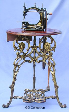 Lockstitch Machine With Treadle And Polished Walnut Table Manufactured By Gresham & Craven, Manchester, England  c.1870's