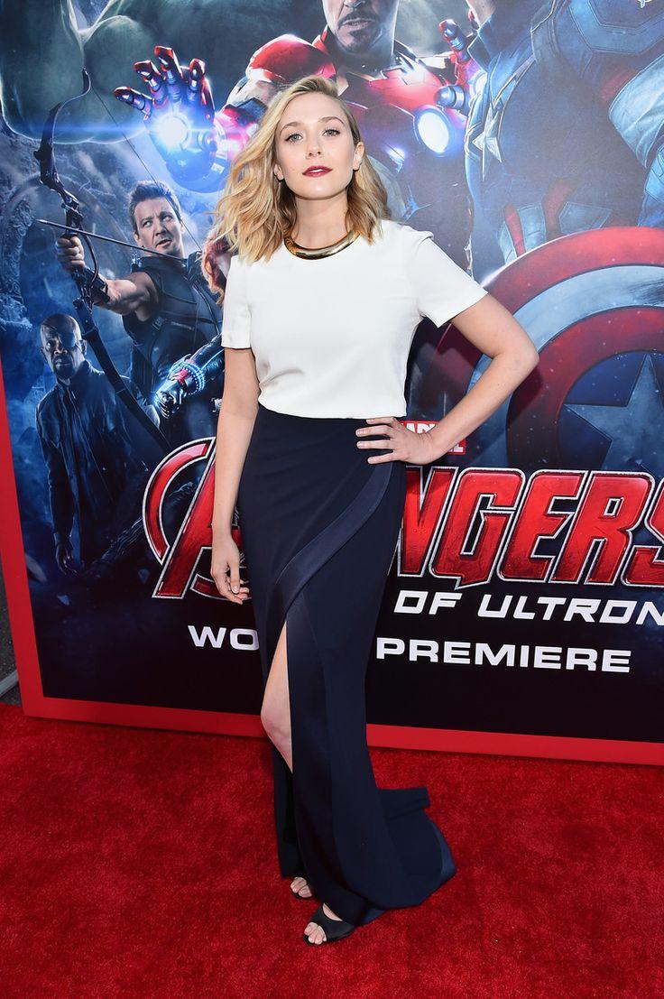 Ook Elizabeth Olsen straalde in een klassieke look tijdens de wereldpremière van de nieuwe The Avengers film. Deze mooie lange donkerblauwe rok met split heeft niet veel meer nodig dan een mooi wit shirt. De statement necklace, rode lippen en zwarte eyeliner passen perfect bij deze outfit.