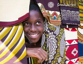 A trip to the bright municipal market. #santorini #mozambique #smile #sarong