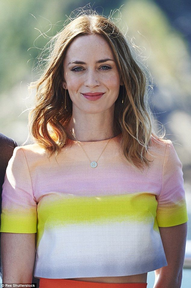 Beautiful: Wearing a pair a multi-coloured crop top and skirt , the acclaimed star sported...