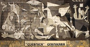 Mural in Guernica based on the Picasso painting. Basque nationalists advocate that the painting be brought to the town, as can be seen in the slogan underneath