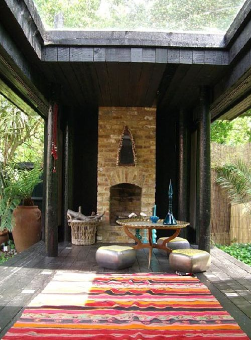 Blissful little spot on the deck to reconnect with close friends. Beautiful fireplace, adorable silver Moroccan poufs & lovely kilim rug. The glass roof is a great idea.