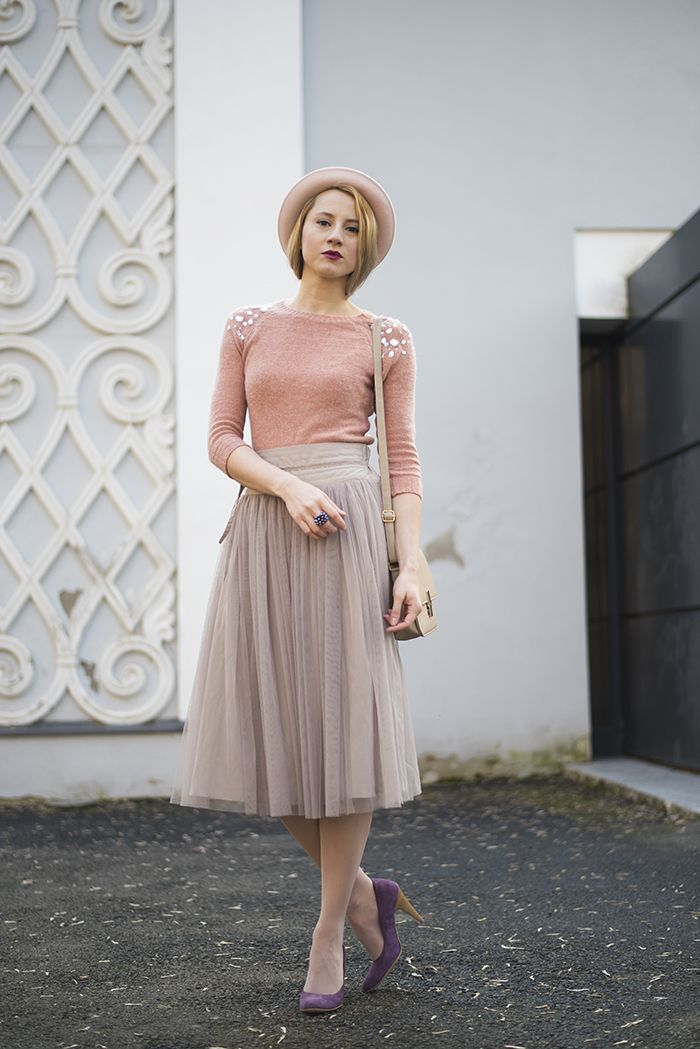 Shop this look on Lookastic:  http://lookastic.com/women/looks/hat-crew-neck-sweater-pumps-ring-midi-skirt-crossbody-bag/9245  — Pink Wool Hat  — Pink Embellished Crew-neck Sweater  — Purple Suede Pumps  — Violet Ring  — Grey Pleated Tulle Midi Skirt  — Beige Leather Crossbody Bag