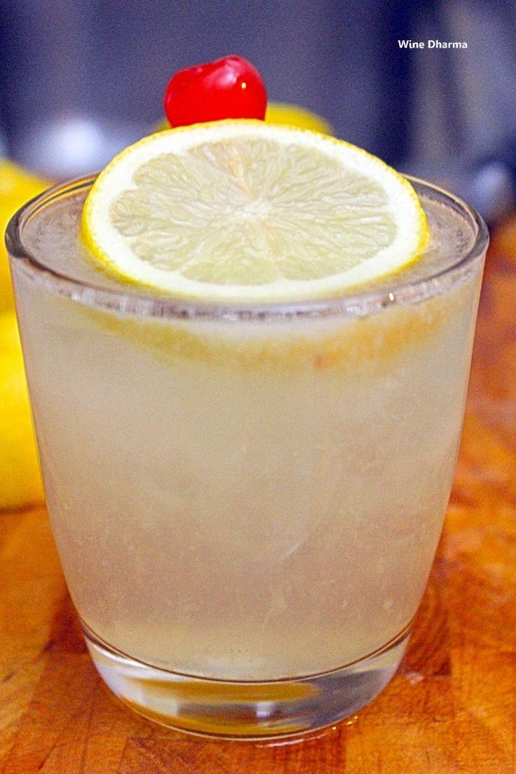 John Collins, cocktail con gin, succo di limone e ciliegina al maraschino http://winedharma.com/it/dharmag/gennaio-2015/john-tom-collins-ricetta-ingredienti-e-storia-di-un-cocktail-mitico