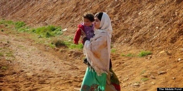 Malala Helps Syrian Children Refugees Cross Jordanian Border