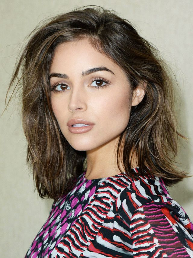 Olivia Culpo with a side-swept, layered lob.