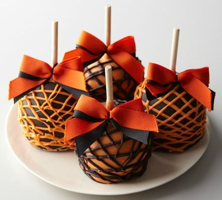 Instead of using caramel, try using melted chocolate instead. Or how about dipping caramel covered apples into melted chocolate? Use brown chocolate and orange colored white chocolate to get these effects. Dip them in one color and let them sit. Once dry, drizzle on stripes in the other color, and top with a bow. So cute!