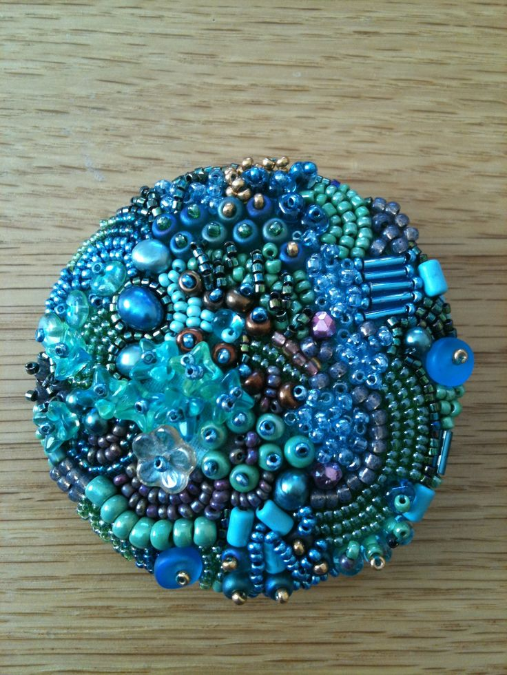 Large button bead embroidery.