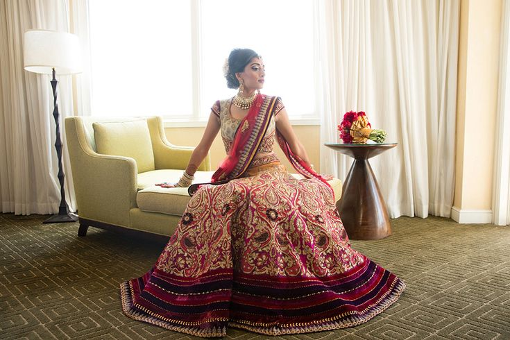 A regal maroon & gold lehenga by Tarun Tahiliani for the wedding of Sneha of WeddingSutra. Photo Courtesy- Duke Photography