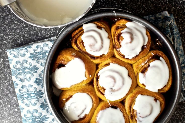 Pumpkin-enriched, fall-spiced, cinnamon-swirled and cream cheese-frosted buns.