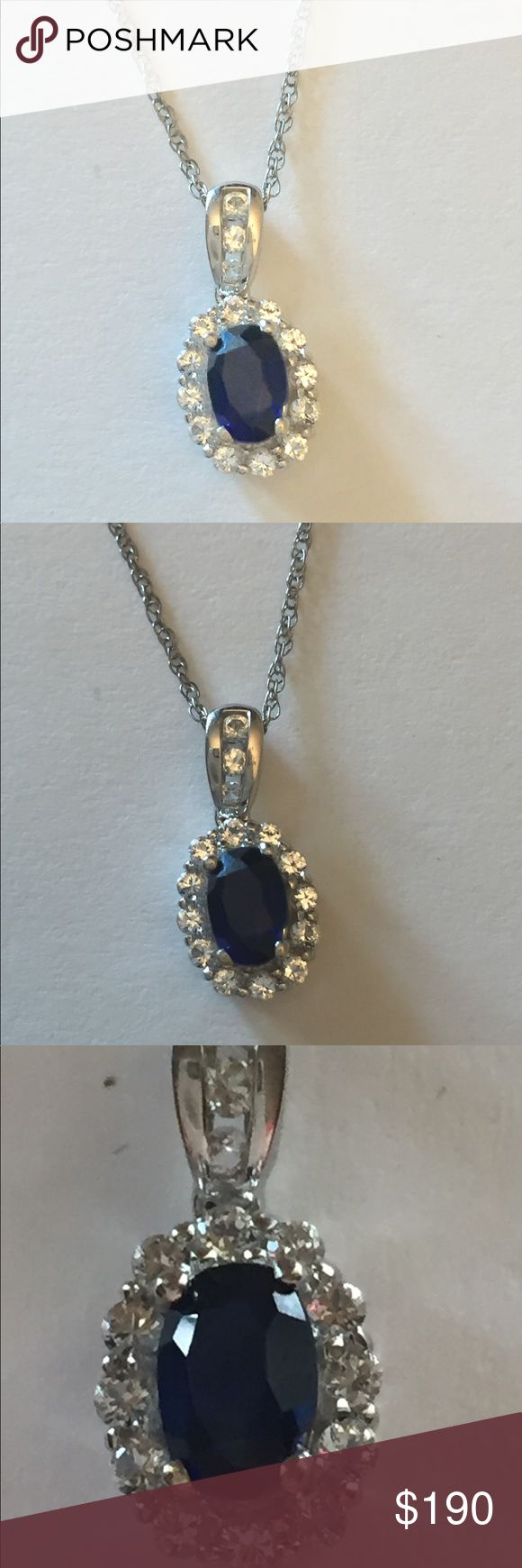 """14 kt necklace with sapphire & Swarovski crystals Brand new made by me in my studio 14 kt white gold (stamped inside the pendant but couldn't get a clear close up, though I tried. See photos.) Genuine Swarovski crystals used in the halo surrounding the real blue sapphire. Chain is also 14 kt white gold (stamped on chain clasp.) 18 """" inch chain. 1/2 carat oval sapphire. Open link chain. Jewelry Necklaces"""