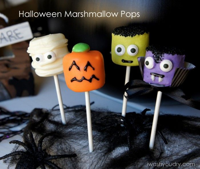 Super Cute Halloween Marshmallow Pops ~ If you're looking for a simple and easy way to WOW your Halloween party guests, then you MUST make these Halloween Marshmallow Pops! I made four different varieties, a Mummy, a Pumpkin, a Frankenstein, and a Vampire. Believe it or not, they are so easy to make.